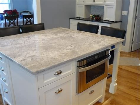 light gray quartz countertops modern white stained wooden island built in microwafe