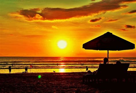 keindahan pemandangan sunset  pantai kuta katalog