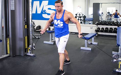 Standing Low to High Cable Fly: Video Exercise Guide & Tips
