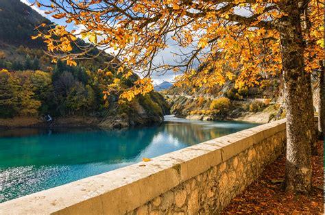 trees river walls mountain fall yellow water