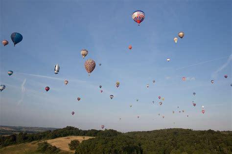 Multi-coloured hot air balloons decorate England skyline ...