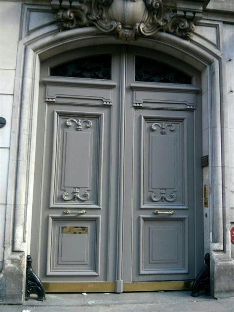 gray classic parisian wooden double door  french