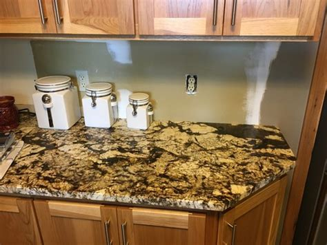 Need backsplash ideas for busy granite countertops in kitchen.
