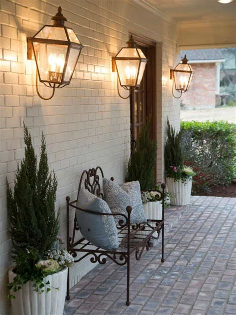 outdoor front porch  metal bench  wall sconces