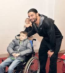 wwe star roman reigns meets harry  lewis  men
