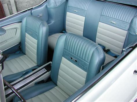 white  mustang convertible  blue pony interior