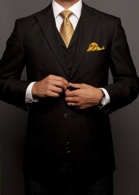 black suit  nice gold tie yellow pocket highlights