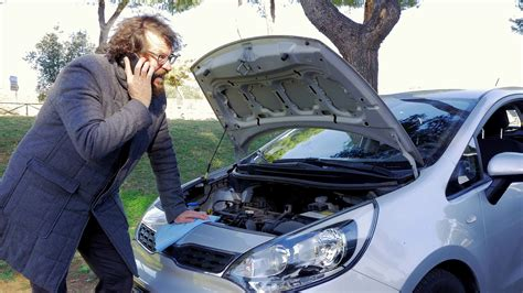 Man In The Street With Broken Car Calling For Help Stock