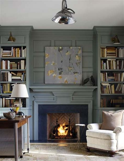 deep grey blue built in bookcases with jointed sconces