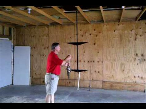 Ceiling Mounted Fishing Rod Holder Plans by Polekaddy Overhead Rod Holder