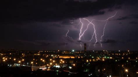 wallpaper lightning city sky clouds hd