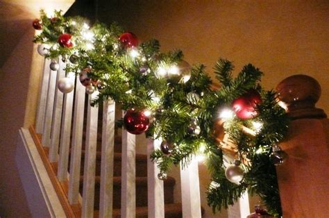 stairway banister decorated for christmas