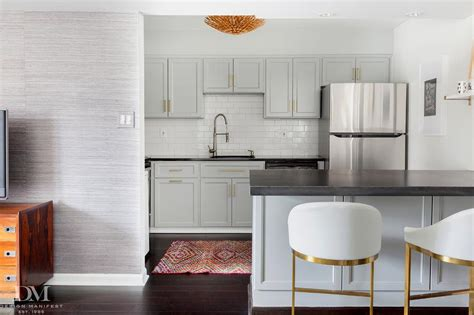gray kitchen cabinets  hot rolled steel countertops