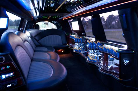 A Limo by Stretch Cadillac Escalade Limo Detroit Limousine Service