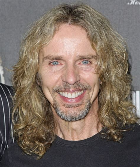 tommy shaw casual long wavy hairstyle light blonde