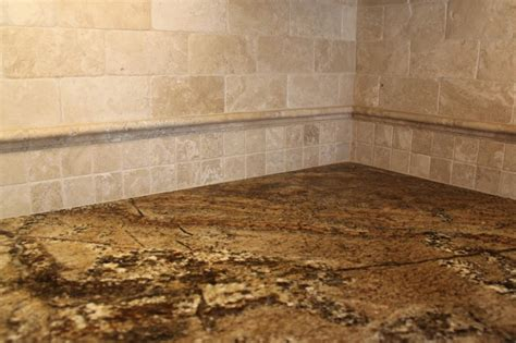 tumbled travertine backsplash with granite traditional