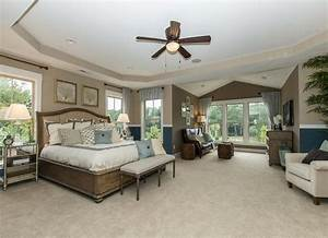 A master suite offers ample space for additional furniture ...