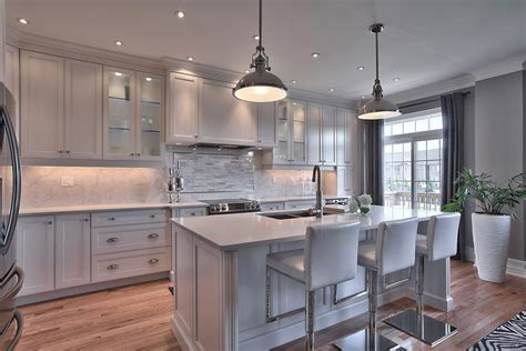Magnificent Carrera Marble look White Kitchen Remodel