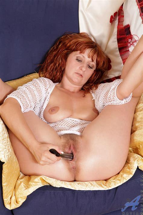 Leggy Redhead Milf Fucks Her Mature Pussy With A Dildo