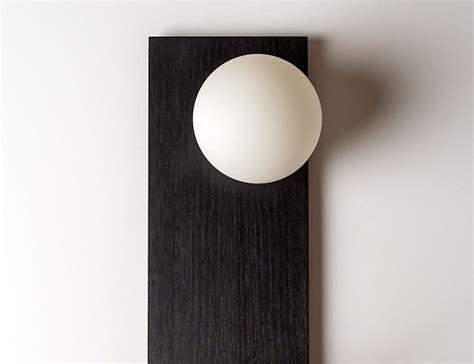 this minimalist shelf wall light is made of handblown glass