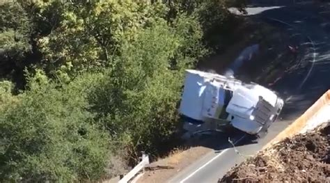 watch big rig driver tries to navigate steep curve goes over embankm wbli