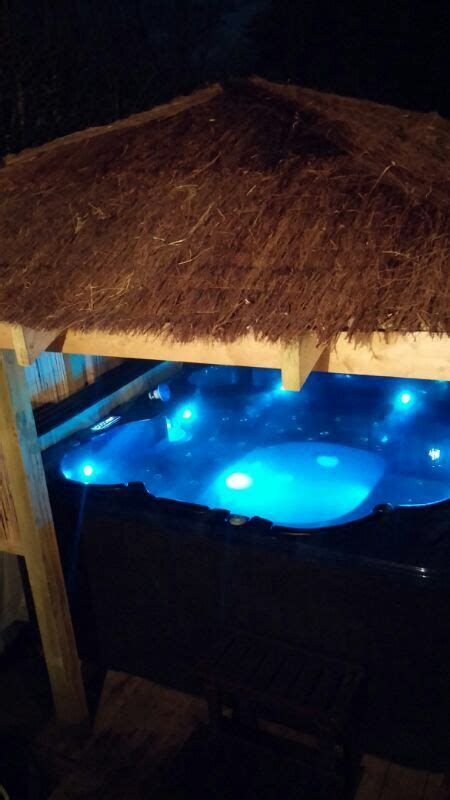 Garden Tubs For Sale by Tub Situated A Gazebo With A Straw Roof For A