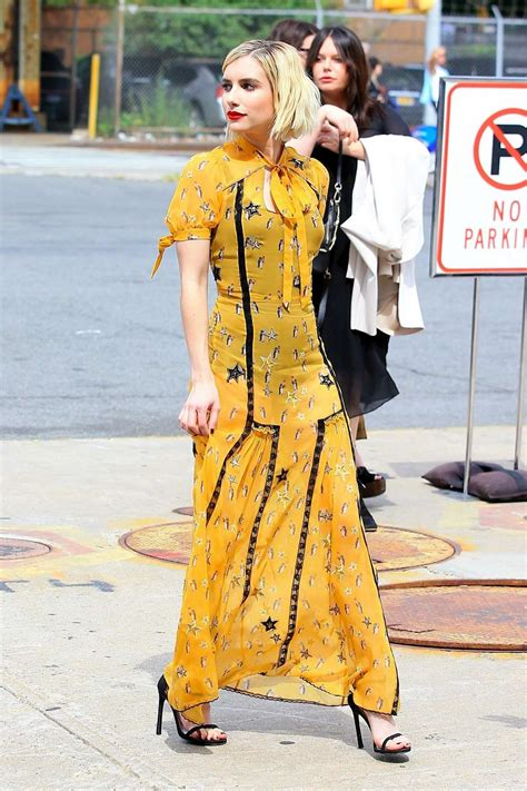 emma roberts in a yellow dress attends the coach fashion ...