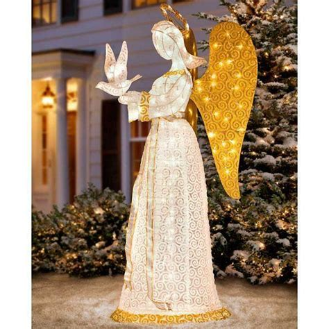 outdoor lighted christmas angel  dove sculpture yard
