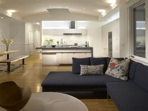 white kitchen connected  family room modern kitchen