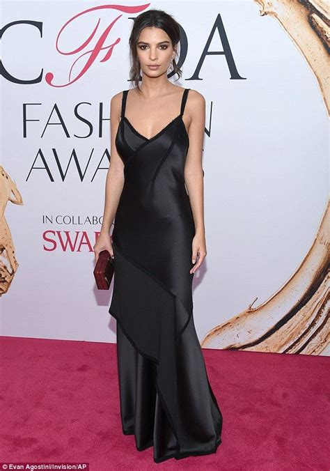 Emily Ratajkowski smolders in figure-hugging silky gown at ...