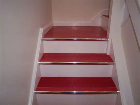 Rubber Stair Nosing For Tile by Red Rubber And Chrome Stair Nosings On Stairs