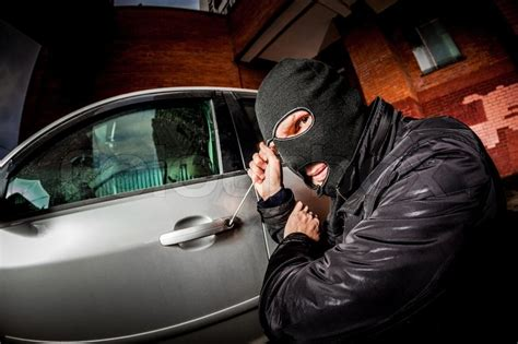 robber   car thief   mask stock photo