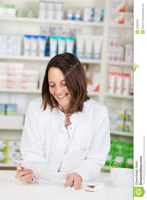pharmacy ls for reading pharmacist reading prescription paper stock photos image