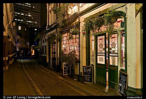 picturephoto saloon bar  cobblestone alley  night