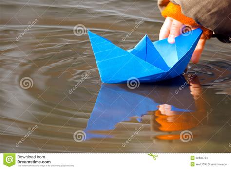 Origami Boat In Water by Blue Paper Boat In Water In Stock Photo Image