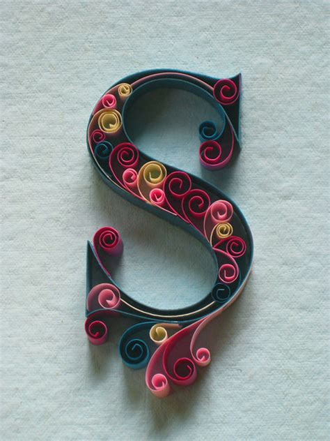 an alphabet of ornate quilled typography