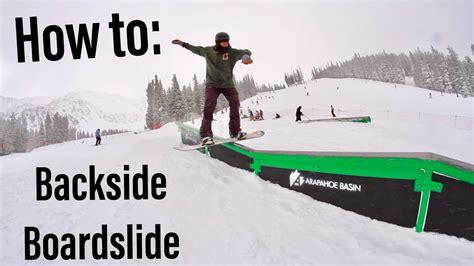 boardslide rail snowboard