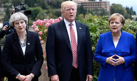 Angela merkel on the sidelines of the g7 summit in japan said that the credibility test at g7 is their ability to defend the common values they share and no change in their stance on the russian sanctions is expected. Angela Merkel makes 'illuminati diamond sign' at G7 ...