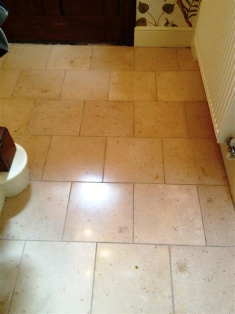 she tip toeing on my marble floors tiled limestone hallway cleaned polished and sealed