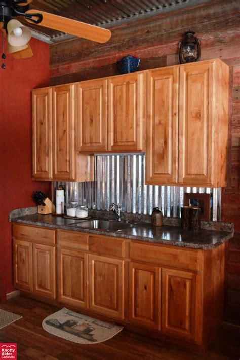 natural rustic alder cabinets knotty alder kitchen cabinets dark granite counter tops