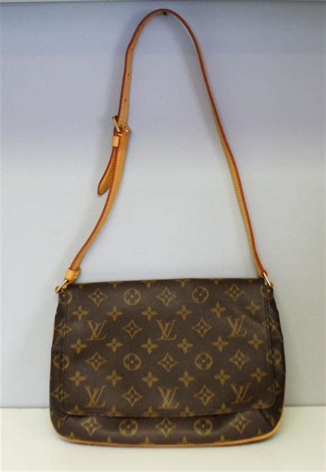 louis vuitton brown monogram musette tango flap shoulder