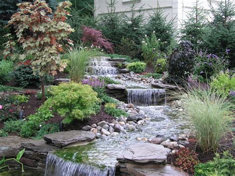 backyard into ponds eclectic landscape york by outdoor magic inc