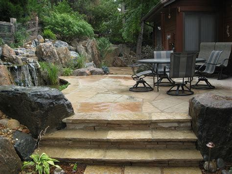 landscaping with flagstone flagstone patio and stairs with boulders