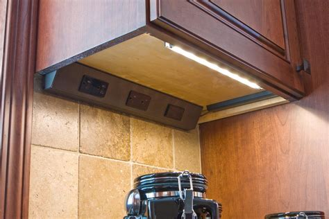 under cabinet lighting with outlets angle power strip task lighting