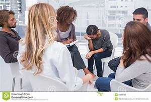 Group Therapy Session With One Woman Crying Stock Photo ...