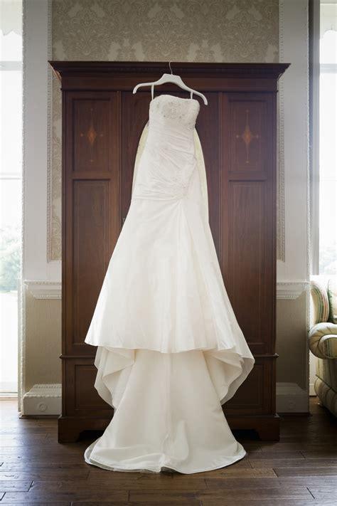 wedding dress hanging   wardrobe wedding pictures