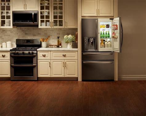 Cream Kitchen Cabinets With Black Appliances