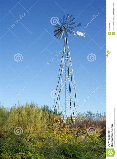 new metal windmill in a garden royalty free stock images
