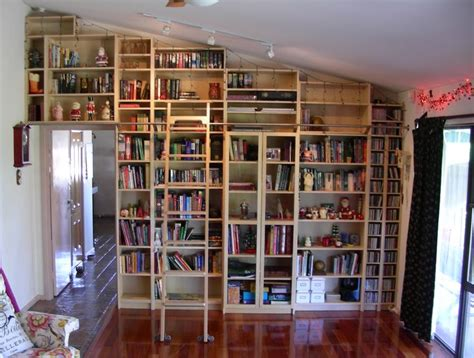 Library Wall With Home Made Rolling Ladder.