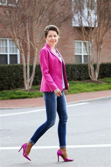 Picture Of With hot pink blazer and cuffed jeans